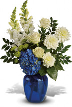 Ocean Devotion showcases blue hydrangea, white or green roses, white hydrangea, white snapdragon and white dahlias in a blue vase in Washington DC and Rockville MD, Palace Florists