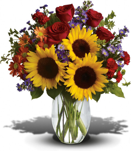 Pure Happiness showcases a vase of sunflowers, bronze daisy mums and red roses in Rockville MD, Palace Florists