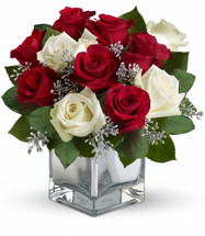 Snowy White Bouquet features lush red and white roses in a silver mirrored cube in Rockville MD, Palace Florists