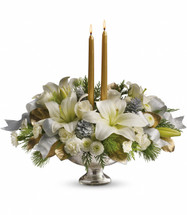 Silver and Gold Centerpiece showcases white roses, white asiatic lilies, white miniature carnations, white button chrysanthemums, seasonal greens accented with small silver pinecones, gold taper candles and silver ribbon designed in an exclusive Mercury Glass bowl in Bethesda MD, Palace Florists