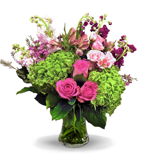Painters Pink with pink roses, green hydrangea, purple stock, alstroemeria and other flowers in clear glass vase in Washington DC and Rockville MD, Palace Florists
