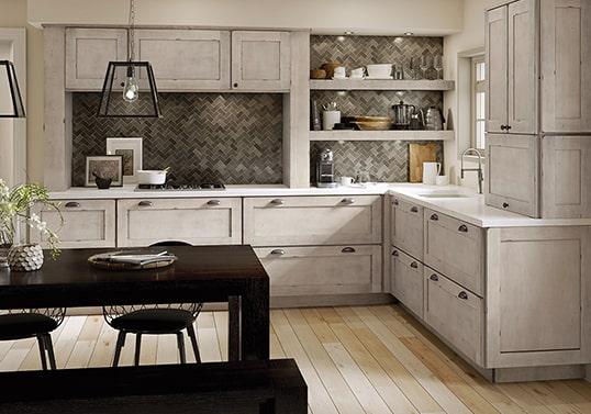 Transitional kitchen in Aged Concrete finish with herringbone tile backsplash