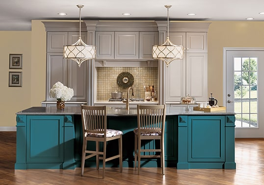 Traditional KraftMaid kitchen in Pebble Grey finish with center island matched to Valspar Ocean Voyage color