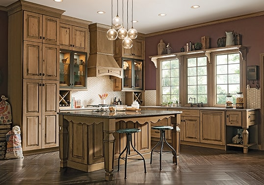 Gothic farmhouse-inspired kitchen in Husk finish with distressed technique