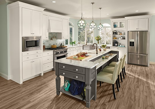 Transitional KraftMaid kitchen in Dove White with center seating island in Greyloft