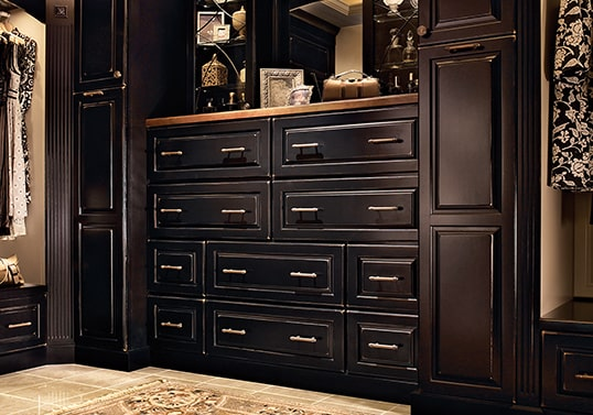 Traditional dressing room with built-in KraftMaid cabinets in Vintage Onyx