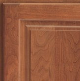 Corner of a KraftMaid cabinet door showing Cherry wood in Ginger finish