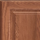 Corner of a KraftMaid cabinet door showing Oak wood in Ginger finish