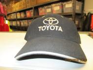 "TOYOTA-BLACK CAP W/ ""TOYOTA"" & CO. LOGO IN ANTIQUE GOLD THREAD-METAL BUCKLE"
