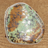 Very large turquise stone with hand tooled bracelet
