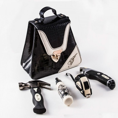 TIFFANY'S TRIANGLE DESIGNER TOOL KIT:  2 COLORS - BLACK & RED The upscale, designer set of household tools skillfully contoured to fit a woman's hand. Designed to reflect a chic and fashionable lifestyle, the unique design, and stylish carrying case can be displayed in any room of the house, readily available for multiple household projects.  Created exclusively for the woman with the most discerning sense of style.