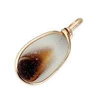 Amber sea glass pontil piece set in gold bezel