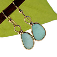 a beautiful pair of sea glass earrings using aqua sea glass and set in gold