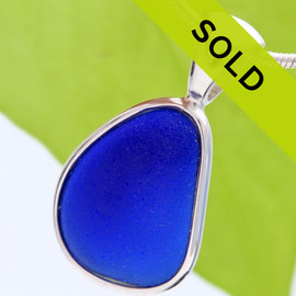 Perfect cobalt blue triangle shaped NATURAL sea glass piece set in our Deluxe Wire Bezel© setting. This setting leaves the sea glass piece TOTALLY UNALTERED from the way it was found on the beach. We do not shape or alter our pieces in any way.  Sorry this pendant has been SOLD!