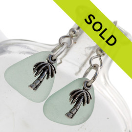 Beautiful genuine seafoam green sea glass set on sterling silver with silver palm tree charms. A lovely pair of sea glass earrings. Sorry this pair of sea glass earrings has been SOLD!