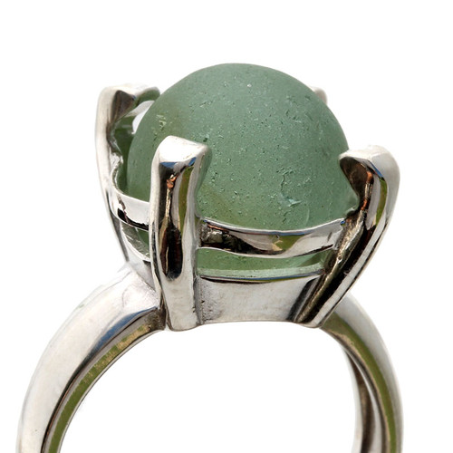 A seafoam green codd marble is set in this solid sterling ring. This is a secure but free floating marble and you will find yourself rotating the marble.......