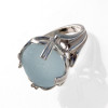 Round Carolina Blue sea glass in a solid sterling ring setting.