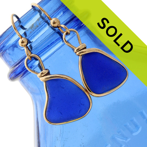 Beautiful natural triangles of cobalt blue sea glass set in our Original Wire Bezel earring setting. SOLD