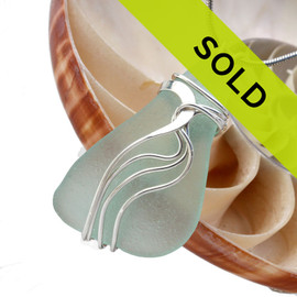 This genuine sea glass waves pendant has been sold!