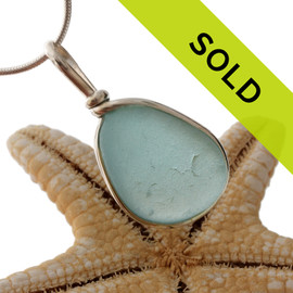 A beautiful piece of aqua blue sea glass set for a necklace in our Original Sea Glass Bezel© setting. Sorry this sea glass piece has been sold!
