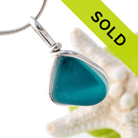 Flashed mixed aqua or teal sea glass from the UK set in our Original Wire Bezel© necklace setting.