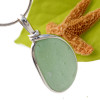 A large perfect rounded piece of seafoam green sea glass in solid sterling Original Sea Glass Bezel© setting