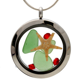 Green sea glass and vivid red gemstones make this a great locket necklace for the holidays.