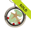 Green sea glass and vivid red gemstones make this a great locket necklace for the holidays. Sold!