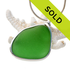Sorry this sea glass jewelry piece has been sold! Our Original Wire Bezel© pendant setting leaves the sea glass totally unaltered from the way it was found on the beach.