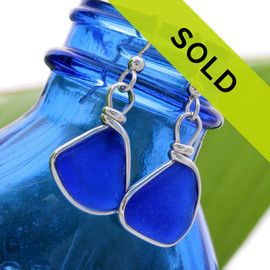 Blue Sea Glass Earrings - A beautiful pair of natural blue beach found sea glass pieces set in our Original Wire Bezel© setting that leaves the sea glass TOTALLY UNALTERED from the way it was found.