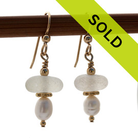 Perfect white sea glass pieces set with AAA grade fresh water pearsl and goldfilled details in this lovely pair of elegant sea glass earrings.