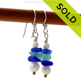 Chunky pieces of blue and aqua sea glass are combined with fresh water pearls in this dangly pair of sea glass earrings. Sorry this Sea Glass Jewelry selection has been SOLD!