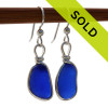 A beautiful pair of natural small but thick blue beach found sea glass pieces set in our Original Wire Bezel© setting that leaves the sea glass TOTALLY UNALTERED from the way it was found.