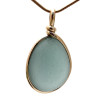 A stunning large and thick piece of gray blue sea glass set in our Original Wire Bezel© setting in 14K Rolled Gold. Much prettier in person!!!!