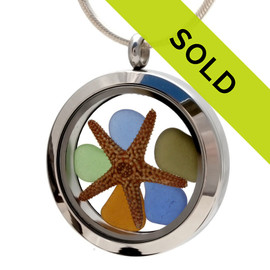 A combo of genuine sea glass pieces in blue, green and amber sea glass pieces combined with a real starfish in this sea glass locket necklace. Sorry this sea glass jewelry selection has been sold!