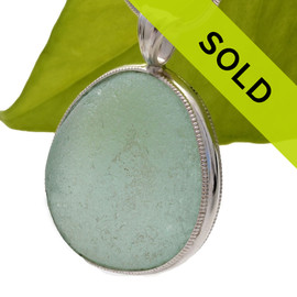 This is a HUGE perfect piece of sea glass from Seaham England set in our Deluxe Wire Bezel© necklace pendant setting. Sorry this piece has been sold!