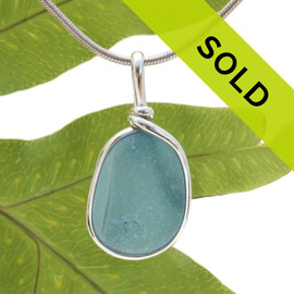 An amazing combination of vivid mixed medium blue in this very old English Sea Glass piece and set in our Original Wire Bezel© necklace pendant setting