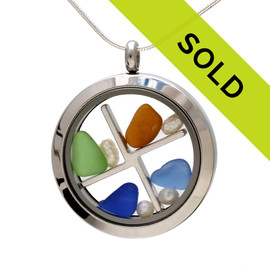 Sorry this locket has been sold! Genuine blue green and amber sea glass combined with a genuine fresh water pearls, in this stainless steel locket.  Pearl is the birthstone for June!
