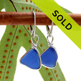 A beautiful pair of natural vivid blue beach found sea glass pieces set in our Original Wire Bezel© setting that leaves the sea glass TOTALLY UNALTERED from the way it was found. This pair comes on our best grade leverback as shown. Sorry this pair of sea glass jewelry has been sold