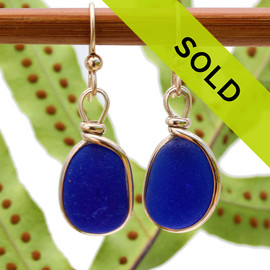 Deep rich cobalt blue sea glass pieces from Seaham England are set in our Original Wire Bezel© 14 K goldfilled earring setting.  Sorry these sea glass earrings have been sold!
