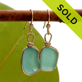 Vivid tropical aqua sea glass from Hawaii is set in our Original Wire Bezel© setting for a stunning pair of 14K gold filled earrings. SOLD - Sorry these Rare Sea Glass Earrings are NO LONGER AVAILABLE!