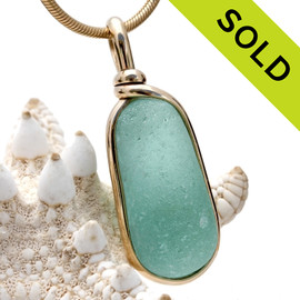 An amazing piece of vivid aqua green natural beach found sea glass from Seaham England set in an elegant classy setting in gold. Sorry this Sea Glass Pendant is NO LONGER AVAILABLE.
