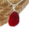 A once in a lifetime piece of large bright red sea glass is set in our Original Wire Bezel© pendant setting. One of the largest red  sea glass pieces we have ever offered for sale.
