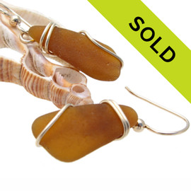 Lighter weight sea glass pieces set in a basic wire setting in 14K goldfilled for a lovely pair of sea glass earrings.