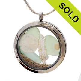 Genuine pastel sea glass pieces combined with a real sandollar, genuine stick pearl and real beach sand in this JUMBO 35MM stainless steel locket.