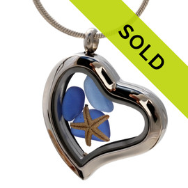Blue beach found sea glass combined with a real starfish in this magnetic heart shaped stainless steel locket necklace.!  Sorry this sea glass jewelry piece has been sold!