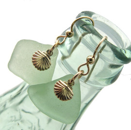 Larger pieces of beach found seafoam green sea glass are combined with 14K G/F shells and presented on goldfilled ear wires.