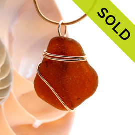 A neat top quality piece of beach found Amber Brown Genuine Sea Glass in a simple wire wrapped gold pendant setting. Sorry this Sea Glass Jewelry selection has been SOLD!