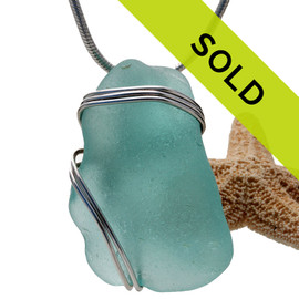 Sorry this sea glass jewelry piece has been sold! A nice chunky piece of vivid aqua sea glass is set in our secure triple sterling setting. A great pendant for any necklace.