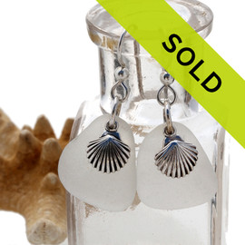 Pure white sea glass pieces set with solid sterling seashell charms for a perfect pair of sea glass earrings.
